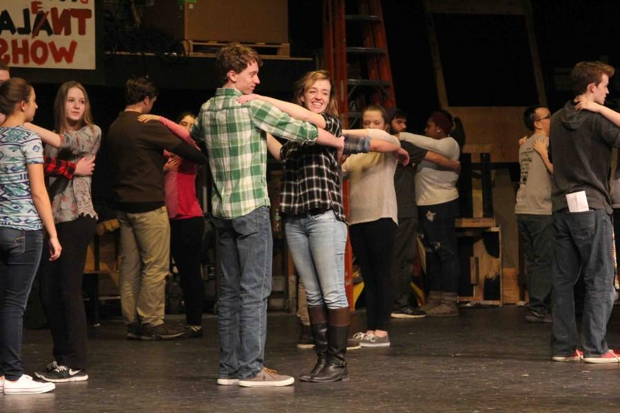 Dancing at auditions for the musical, senior Leah Lynch smiles as her and sophomore Arlo Simmerman dance at auditions.