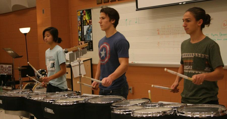 Drumline members (left to right) Kayla Csapo, Jonathan Fleck, Dom Dimambro