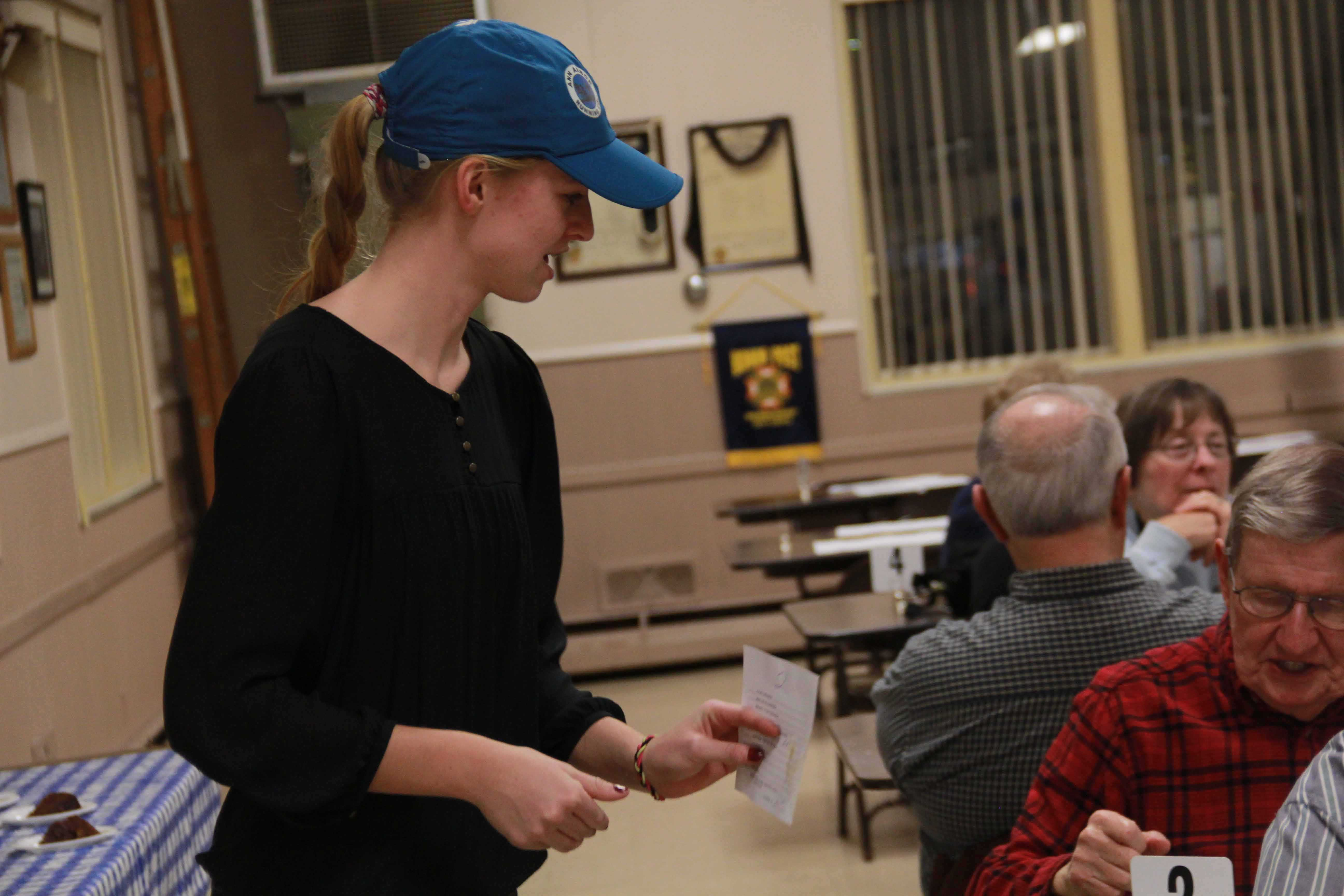 Junior Jenna Keiser volunteers at the VFW Hall for their weekly Friday Fish Fry. NHS volunteers help out at the Fish Fry every Friday, making it one of the main events of the organization.