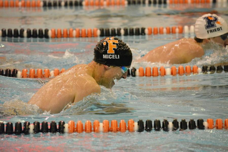 Varsity boys break two long lasting records at State Finals