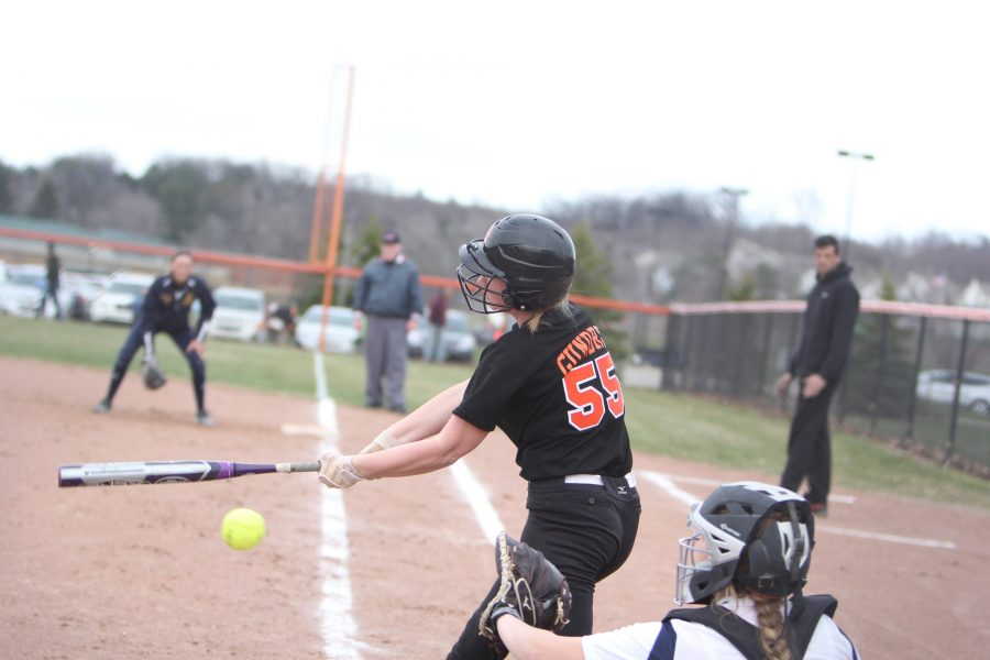 Sophomore+Molly+Gundry+swings+at+the+ball+while+up+at+bat.
