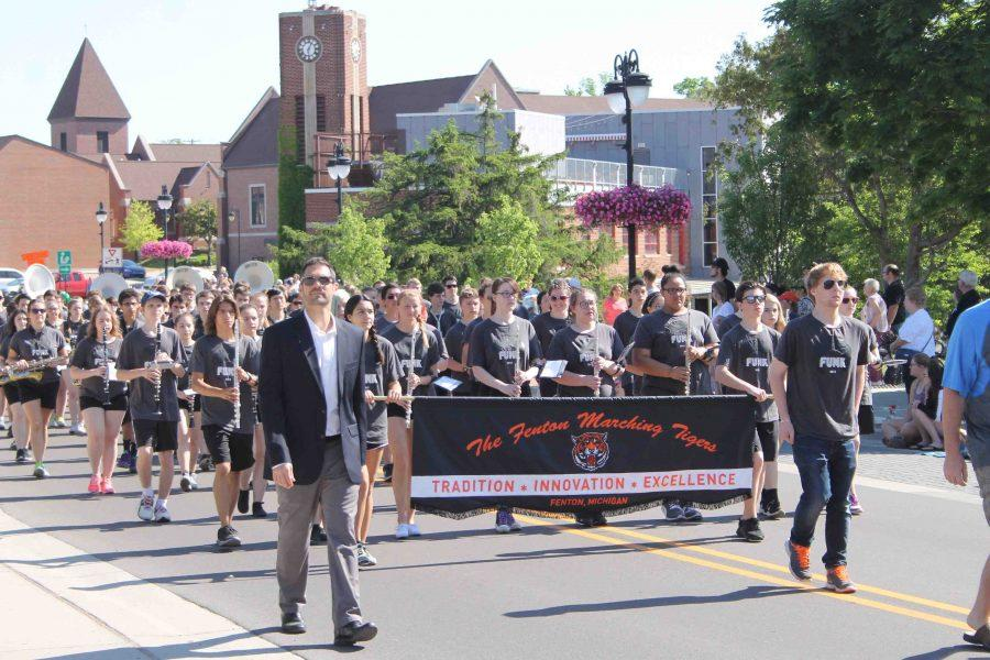 The high school band marched in Fenton's Memorial Day Parade, they played songs like God Bless the USA.