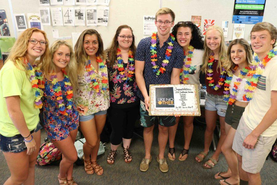 The yearbook staff received the shipment of the yearbook on Wednesday. They had a party to congratulate the seniors on their staff.