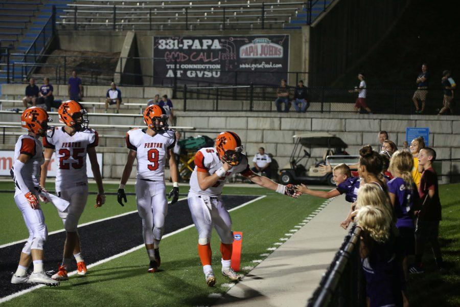 Junior QB Josh Czarnota scurries into the endzone and then high fives an opposing fan during one of many scoring drives for the Tigers.