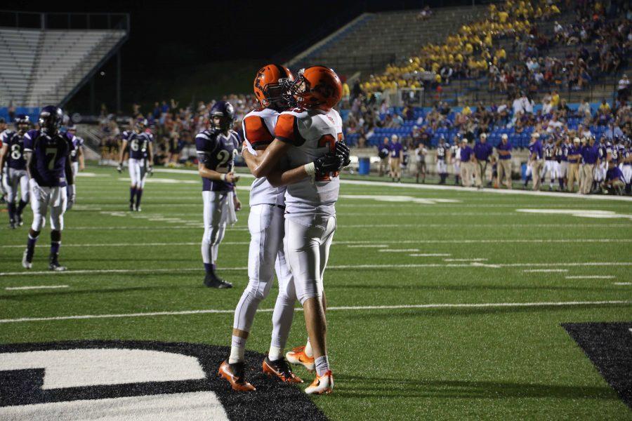 Senior WR Alex Marshall hugs senior WR Zach West after scoring a touchdown during the third quarter.