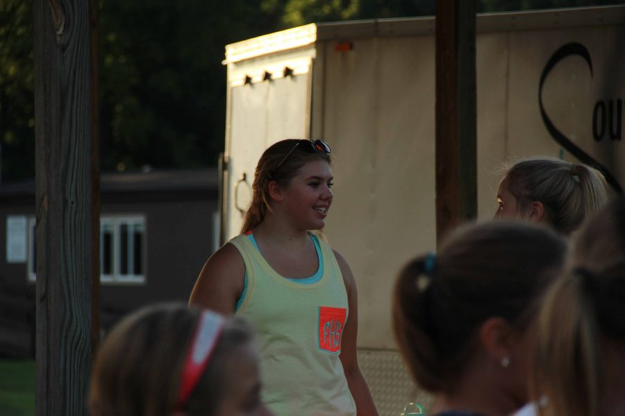 As Sydney Stossel talks to her best friend on a hot August 25th as they take a quick water break before going back and helping the youth cheerleaders. They enjoyed helping the young cheerleaders and hope to see them make varsity one day.