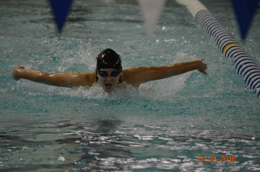 Finishing her event with a MISCA qualifying time, sophomore Caitlyn Dailey swims in the 100 yard butterfly.