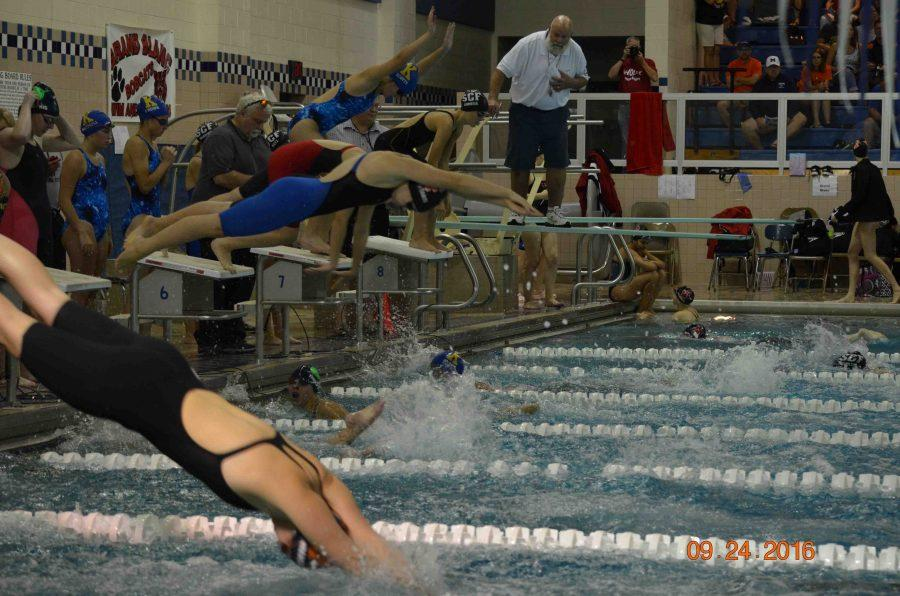 Diving into the pool with her relay, sophomore Bre Ferranti competes in the 200 yard freestyle relay. The relay finished with a MISCA qualifying time.