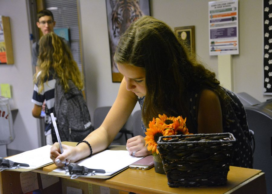 During passing time in the Counseling Office, Junior Julia Acton signs up for an appointment to see her counselor.