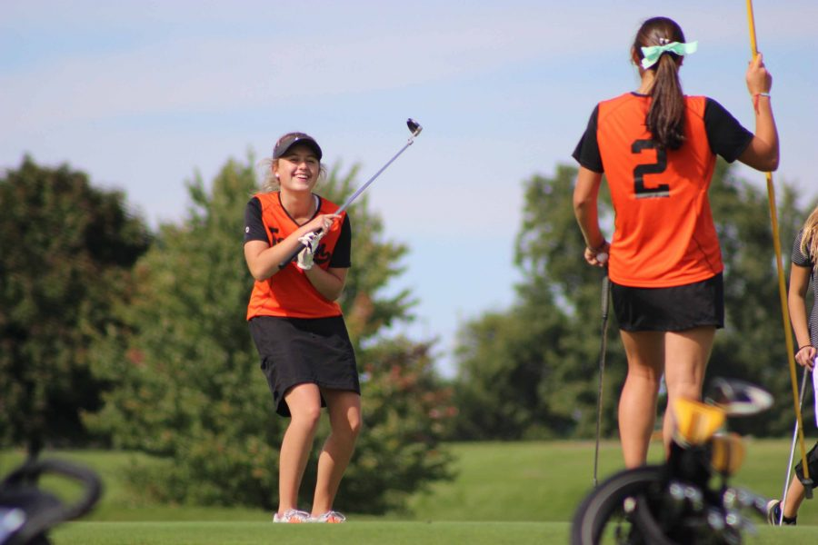 Half way through their match, sophomore Lily Horning, swings her club and smacks the ball. Following the cracking sound of the ball hitting the club, Horning cracks a joke with her team mate, junior Margaret Berry.