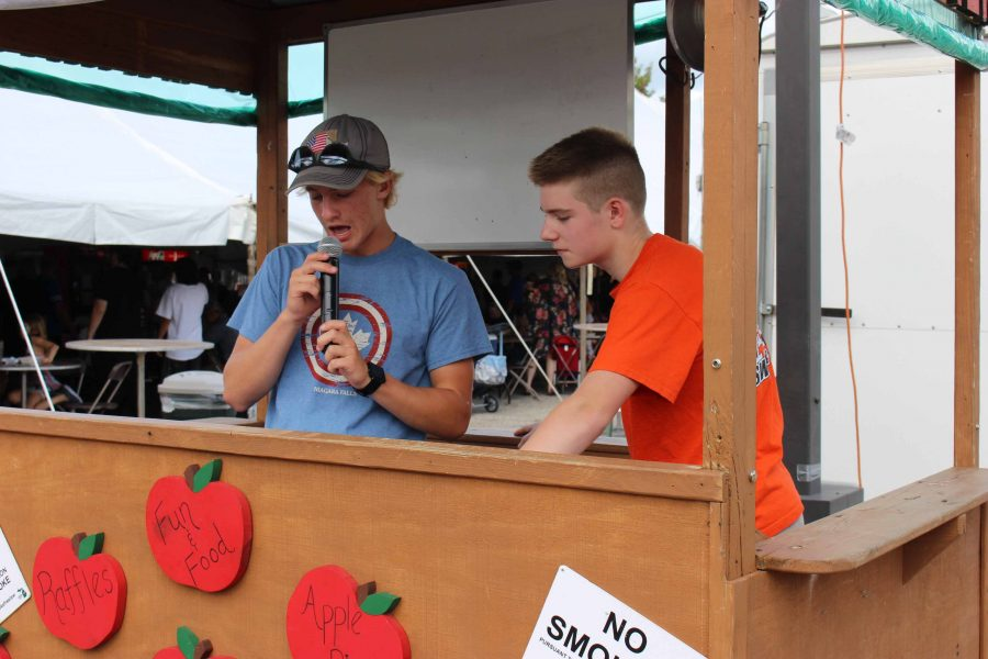 At the 44th annual, St. john's Applefest, sophomores Noah Maeir and Evan Barto start up announcements. Following the announcements, Maeir and Barto enjoy themselves at the fair.