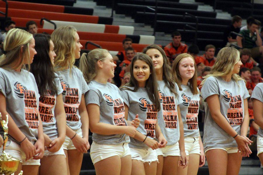 The Varsity Volleyball team stands in front of their family and friends at Meet the Team. The group shared laughter while being introduced by their team captains at the event on August 18th.