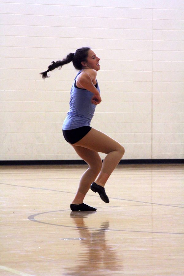 As the song Pep Rally by Missy Elliot plays in the background, sophomore Jamie Elrod free style dances. Each dancer took their turn dancing to this song, as they prepared for it to be the song they used for their first dance of the year.
