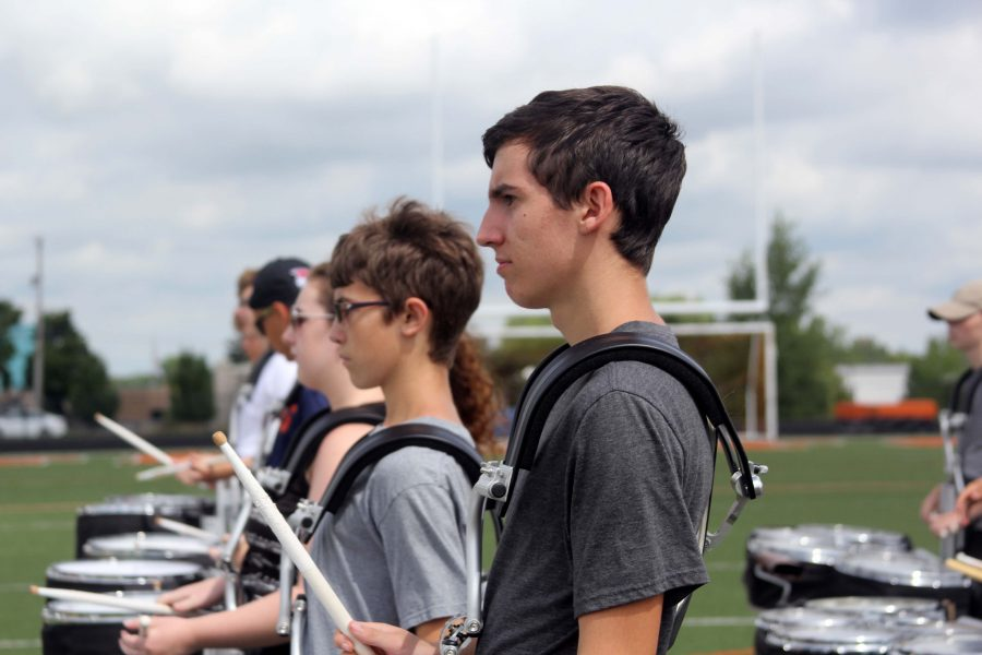 Sophomore Skyler Koleda marches intently while listening to Andrew Perkins' directions. Koleda, along with the rest of the band, marched across the football field and played their parts for the song