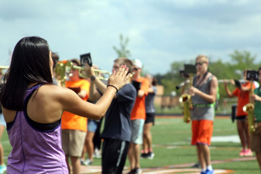 Junior Ariana Mansour directs the marching band during their practice on August 25th. Mansour, along with senior Chase Raymond, were in charge of making sure everyone was working hard and learning their new songs for this year's football games.