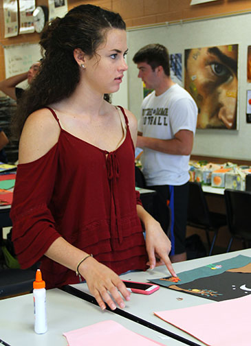 On the first day of Jessica Lynch's junior year, she cuts and pastes paper bits into a beautiful photo for her Art class.