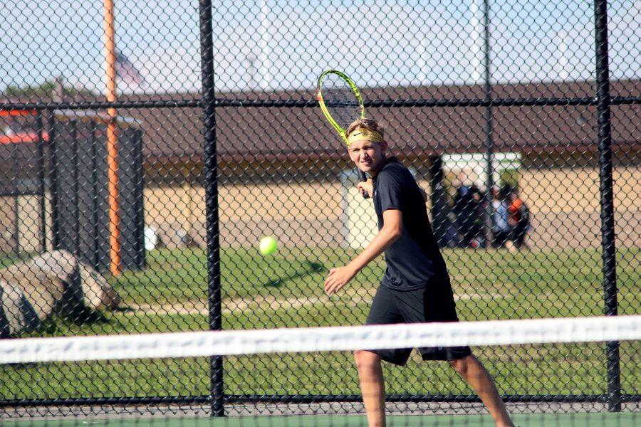 Brendan Remillard, senior, practices with his teammates before starting their match on Sept. 19. The boys varsity tennis team played against Lapeer and won.