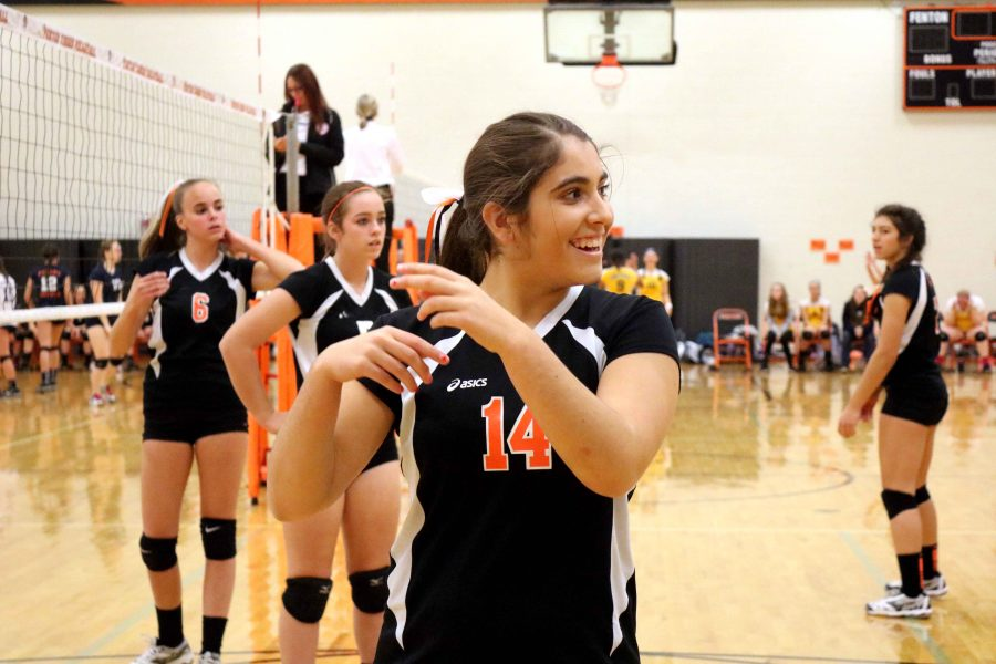 Marissa Delecki playing her last freshman volleyball game against Goodrich and Powers. The girls won all of their matches beating both teams and going undefeated this season.