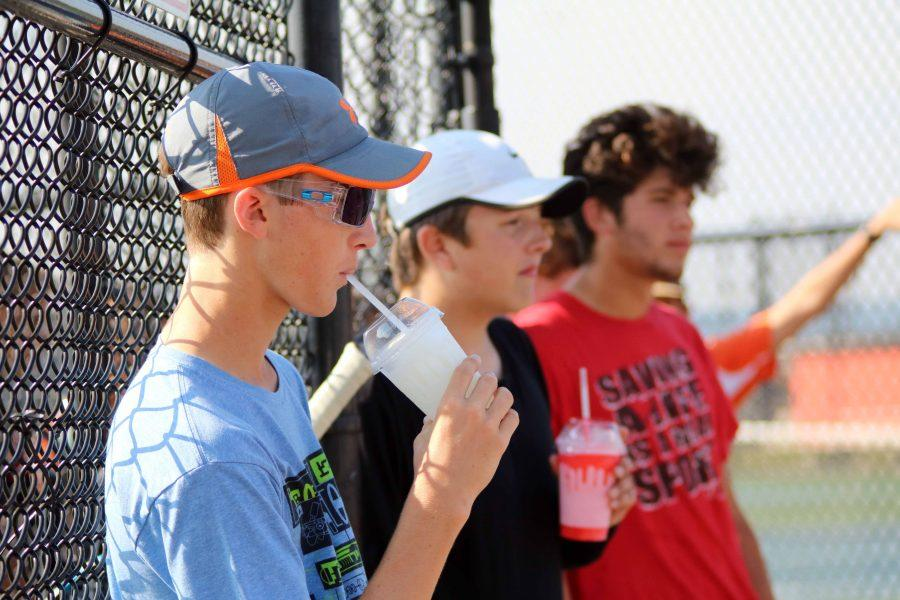 During practice, senior Trevor Dymond and the rest of his team take a break. Their coach rewarded them for their hard work leading up to Regionals the next day with slushies.