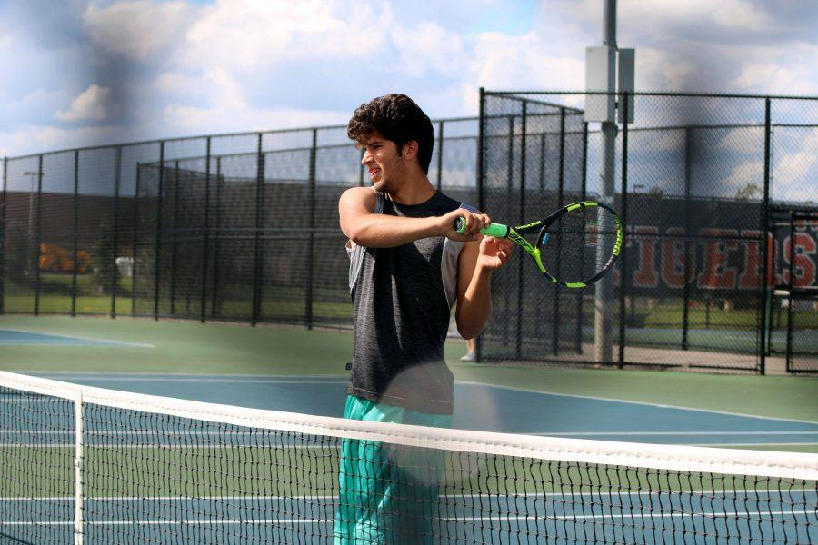 Senior Don Doyle prepares to hit the ball during Varsity Tennis practice on September 26. The team was preparing for Metros, which was the next day in Flushing.