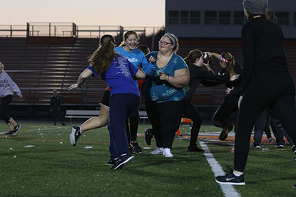 During their final practice, Senior Abby Hager blocks Senior Jen Eisenbeis. The two played against the Juniors on Monday night in the powderpuff game.