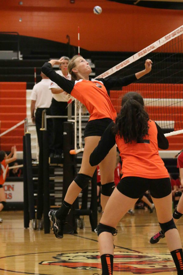 Getting ready to spike against Holly Sophomore Hanna Chapin moves forward along with the rest of the JV team. The lady tigers defeated Holly by winning all 3 of their games.