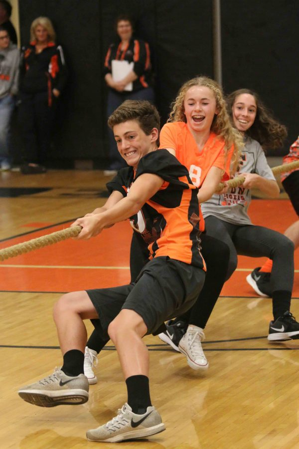 Freshman Lucas Clayborn participates in his first tug of war competition against the Seniors during the homecoming pep assembly. As expected among the classes and staff the Seniors defeated the Freshman which placed them in last place.
