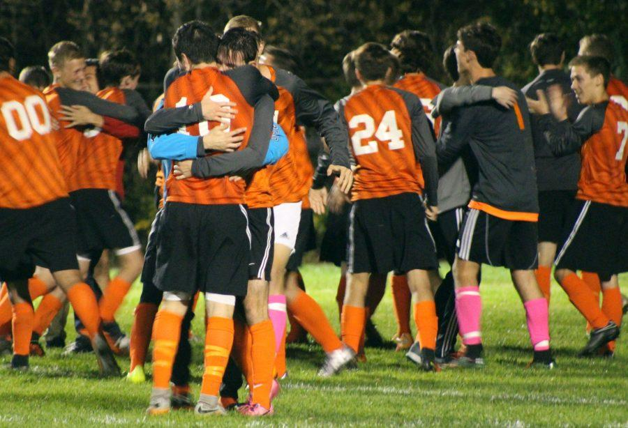 After the district semi-finals, the boy tigers cheer and hug each other in celebration. They won against the Linden Eagles after two 10 minute over times, and a shoot out before winning 3-2. They then moved on in the playoffs and as of Thursday, Oct. 27 the boys are Regional Finalists with the final score of 1-0.