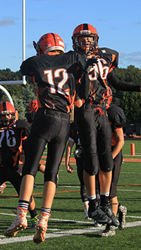 Freshmen Kade Lookebill and Grahm Staib celebrate after Lookebill scores a touchdown in the second quarter against Hamady High. The boys won the game with a score of 40-2.