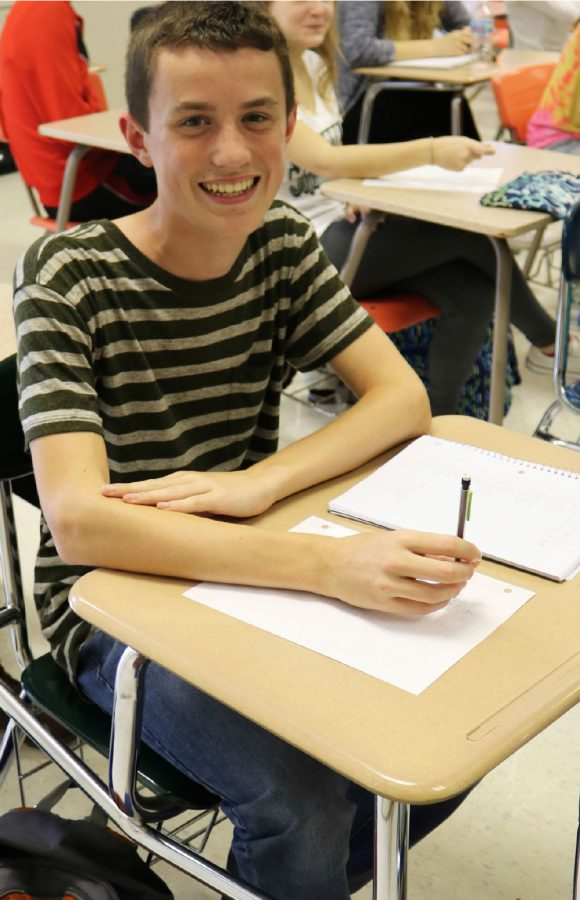 Eight grader Ryder Spees sits among his fellow Algebra 2 classmates, all several years older than him.