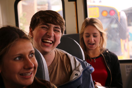 Laughing at his friends joke, junior Devon Mann waits for the bus to begin the ride home. On Monday, Mrs. Bunka's InPrint and Fentonian Staffs attended fall Mipa in Lansing to learn more about journalism and yearbook.