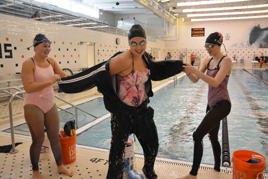 Leading her relay team in her last hell week, senior Elise Cassidy participates in the traditional halloween relays with the rest of her team. Every year the girls swim team end their long tedious hell week on a fun note by competing against each other in halloween relays.