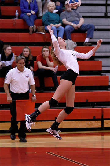 Senior Jessica Warford serving in the semi-finals for the varsity volleyball regionals. They won in the fifth game with a score of 17-15 and will compete against Clarkston for the regional title.