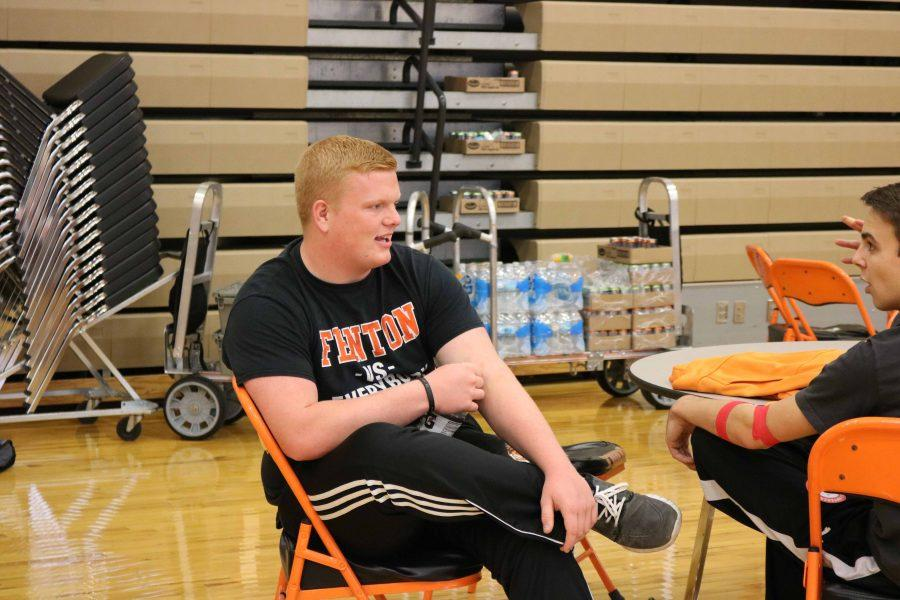 While volunteering at the first blood drive of the year, seniors Reid Thompson and Sean Stiles take a break. They, along with many other NHS members, spent most of the day helping out at the blood drive.