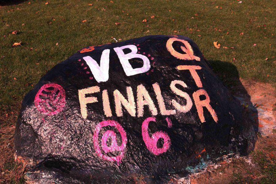 The varsity girls volleyball team painted the schools rock to spread word of the Regional Quarter finals tonight at 6 p.m. There will be a student-fan bus, ticket for bus and the game are being sold for $10 in the athletic office.