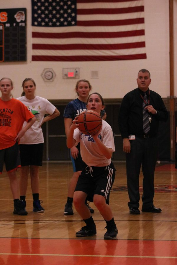 Lauren Bossenberger focuses as she shoots the ball, trying her hardest at basketball tryouts.