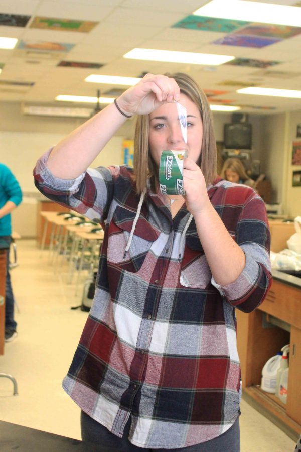 While practicing lifting finger prints in her forensics science class, senior Meaghan McArdle uses the techniques she earlier learned from officer Mathewson. In the forensics classes they have many guest speakers that have experience and they come in and talk to the class at different times of the year.
