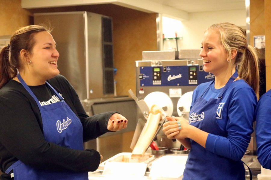 During the Culver's fundraiser on Dec. 7, senior Shelby Kienast and freshman Abby Sizemore take a break from working. The two members of the publications staff were volunteering at the fundraiser supporting both the Inprint and Fentonian.