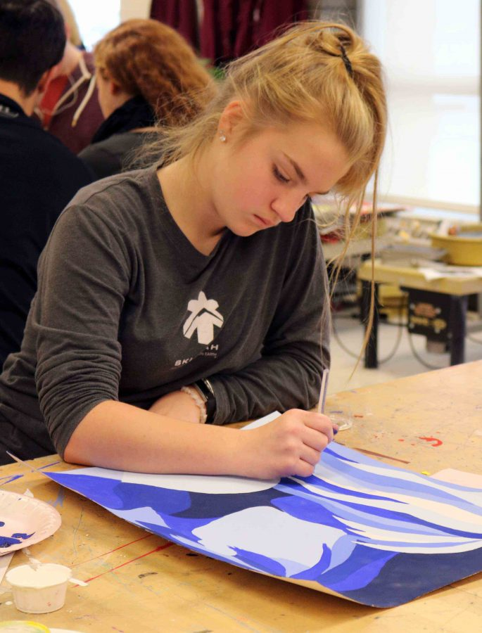 During Teresa Moss's 3A Art foundation class freshman, Julia Young finishes up on her color painting. Young used shades of blue to add contrast to her artwork.
