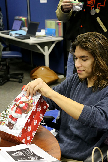 Senior Emilio Caballero in VEI class opening his present for his Secret Santa on the 16. In class this year they picked names to buy present for each other to exchange.