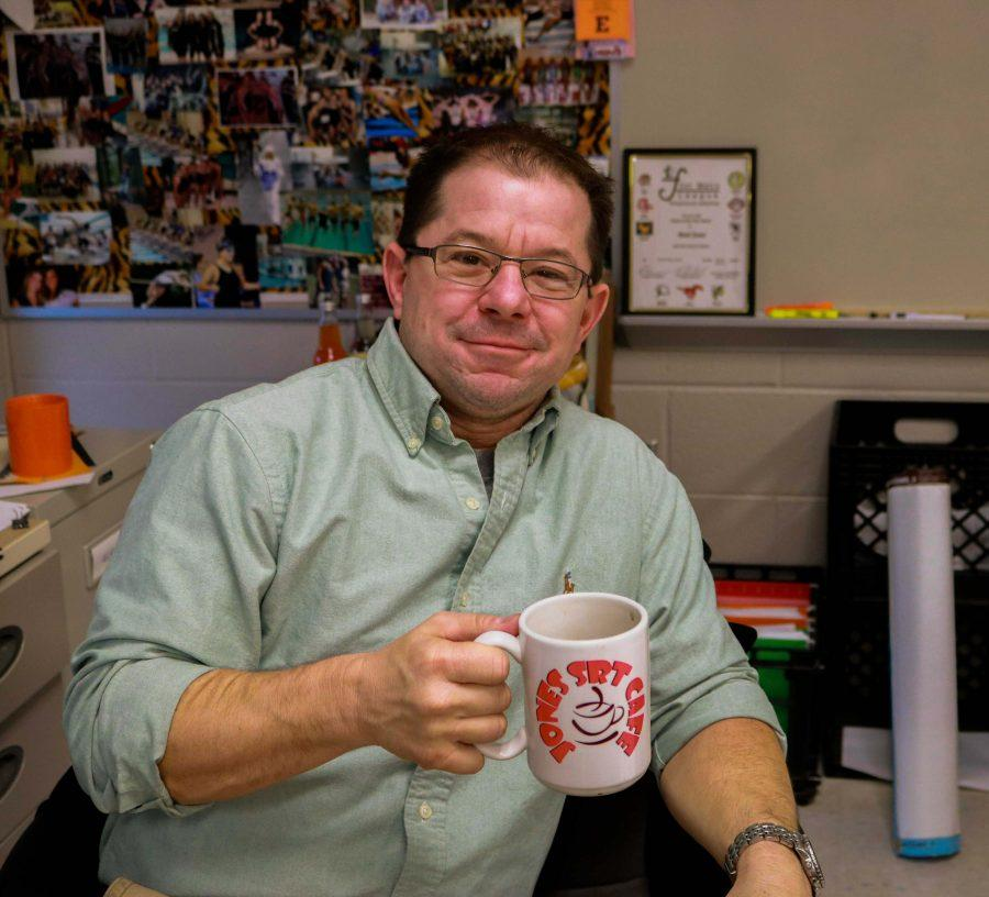 History teacher Bradley Jones approves the sample mug design for his SRT Cafe. With this, their will be a shipment of a classroom set of mugs for the rest of the students.