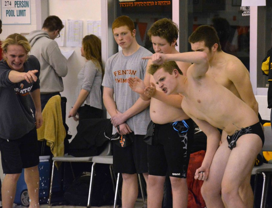 Cheering on his teammates this past weekend, sophomore Jake Iddings shows his tiger spirit. Fenton competed against multiple teams around the county and won second place overall.