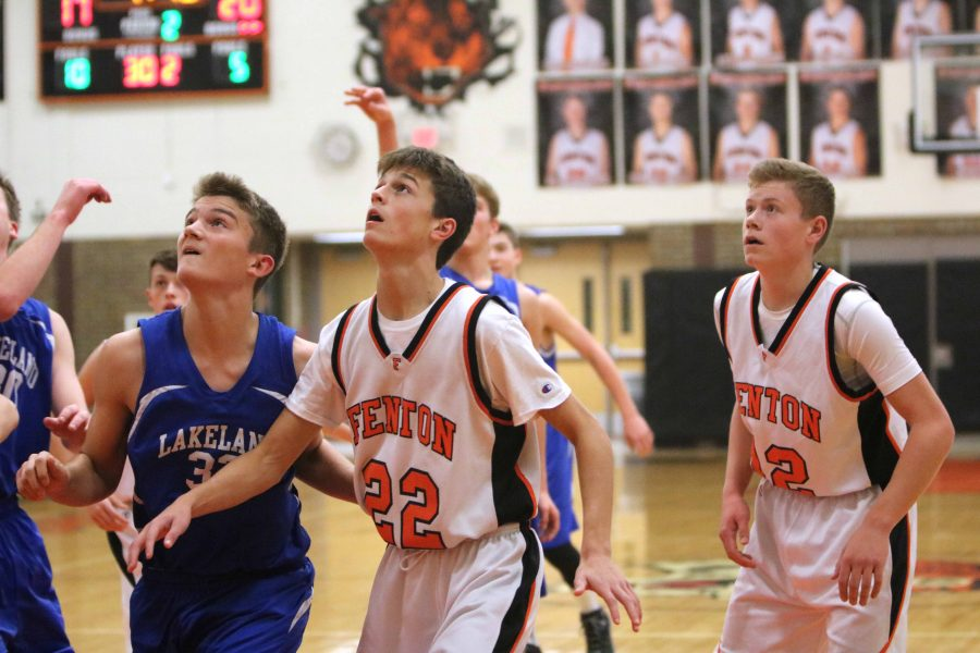 Looking up at the basket, freshman Ryan Miller waits for an opportunity to get the basketball with some of his teammates. Their team played against Lakeland on December 20.