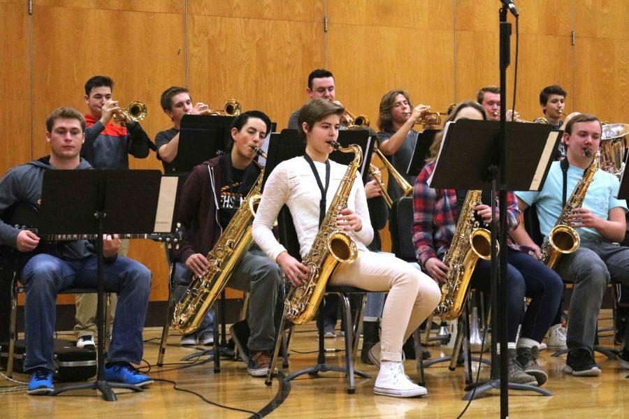 During the holiday concert before winter break, sophomore Caitlyn Dailey plays the saxophone with the rest of the band. Later in the concert, Dailey had a solo.