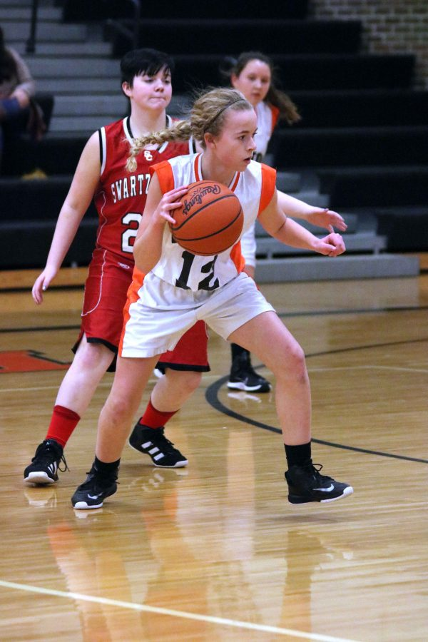 In the freshman girls basketball game against Swartz Creek, Audrey Weir dribbles down the court. The team won with a score of 38-23.