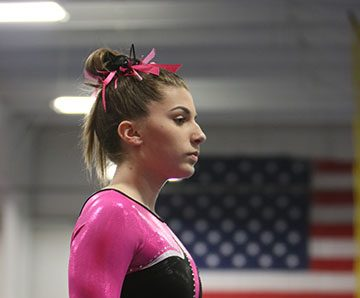 Freshman Morgan Smith preparing herself for her floor routine at the Hartland Ice House Gymnastics Tri-meet. Her routine scored an 8.6.