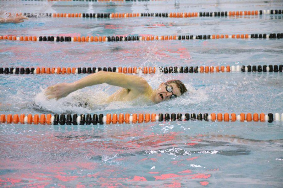 As he glides through the water, senior Kyle Banner competes in the 200 Freestyle. Fenton won against Owosso and Notre Dame last Tuesday.