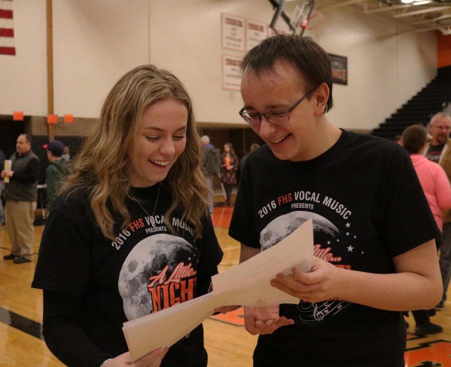 Sophomore Alex Marsee and junior Joe Amberg attend the freshman orientation at Fenton High. They were there to represent Varsity Vocals.