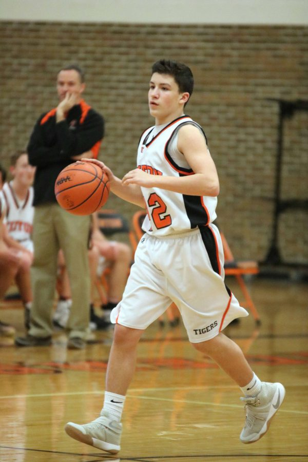 Dribbling the ball, freshman Mason Turner makes his way toward the basket. He, along with his teammates, played against Kearsley on Feb. 9th.