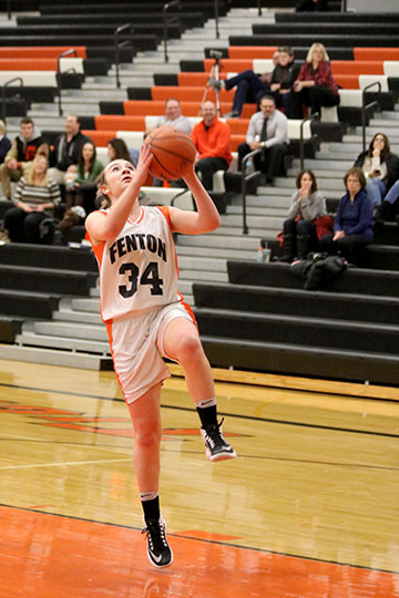 Lilly Mckee making a lay-up for the freshman girls basketball team in a game against Davison.